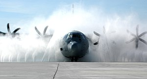 Keesler Air Force Base - A Lockheed Martin C-130J Super Hercules is cleaned up in the new wash system at Keesler.