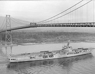 HMS Warrior (R31) - HMCS Warrior passing under the Lions' Gate Bridge, ca. 1946–1947