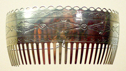 Ornamental hair comb by Bruce Caesar (Pawnee-Sac and Fox), 1984, of German silver, Oklahoma History Center Caeser Bruce silver comb 1984 ohs.jpg