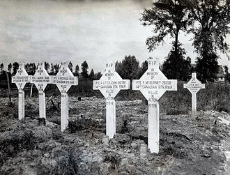 Commonwealth War Graves Commission - Canadian war graves near Ypres, Belgium. The crosses identify the graves as those of soldiers of the 14th Canadian Battalion who were killed over several days in May 1916.