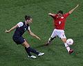 Carli Lloyd Nahomi Kawasumi Japan vs USA.jpg