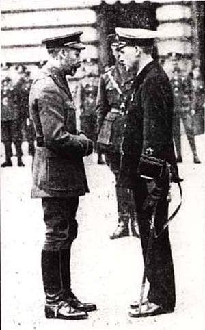 Ronald Stuart - Ronald Stuart receiving his VC from King George V outside Buckingham Palace