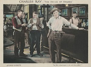 Andrew Arbuckle (actor) - Lobby card for The Deuce of Spades (1922) with Arbuckle (center)