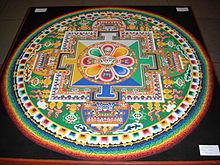 https://upload.wikimedia.org/wikipedia/commons/thumb/d/da/Chenrezig_Sand_Mandala.jpg/220px-Chenrezig_Sand_Mandala.jpg