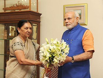 Chief Minister of Gujarat, Smt. Anandiben Patel greets the Prime Minister, Shri Narendra Modi on his birthday (15089432397).jpg