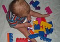Child playing with large Mega Bloks.jpg