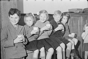Education Act 1944 - Five children enjoy their morning milk in a classroom in 1942.