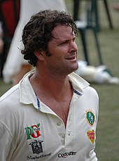 Chris Cairns in white cricket shirt