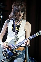 Chrissie Hynde playing guitar onstage