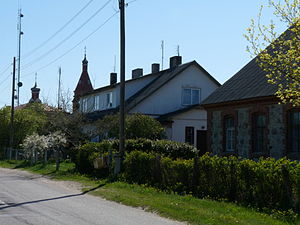 Kolka, Latvia - Former Orthodox seminary and Russian Orthodox church in the background