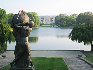 Cleveland Museum of Art - View of the museum from the steps of the Euclid Avenue entrance to Wade Park, overlooking the Lagoon. Seen in the foreground is Frank Jirouch's 1928 bronze sculpture, Night Passing the Earth to Day.