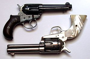 "Colt M1877 - Colt ""Thunderer"" with ejector (above), compared to Colt Single-Action Army (below)."