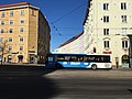 Curved building and bus (28978080547).jpg