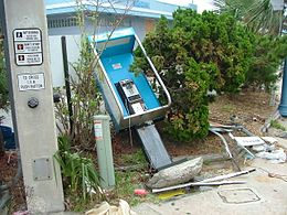 Wrecked phone booth in Daytona Beach, located at the corner of highways US-92 and FL-A1A. Damage caused by 2004 Hurricane Frances.