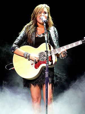 Demi Lovato - Lovato performing during the Jonas Brothers Live in Concert World Tour in September 2010.