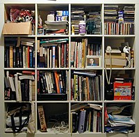 Disorganised bookshelf.jpg