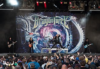 DragonForce - DragonForce in Germany in 2018. From left to right: Frédéric Leclercq, Herman Li, Gee Anzalone, Marc Hudson and Sam Totman.