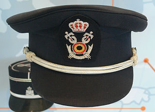 Peaked cap Form of uniform headgear with a short visor, crown, band, and insignia