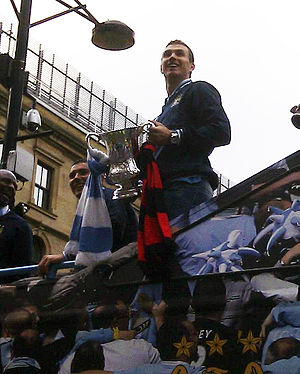 Edin Džeko - Edin Džeko celebrates winning the 2011 FA Cup with Manchester City.