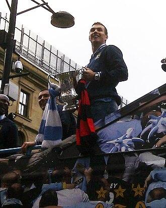 Edin Džeko - Edin Džeko celebrates winning the 2011 FA Cup with Manchester City.