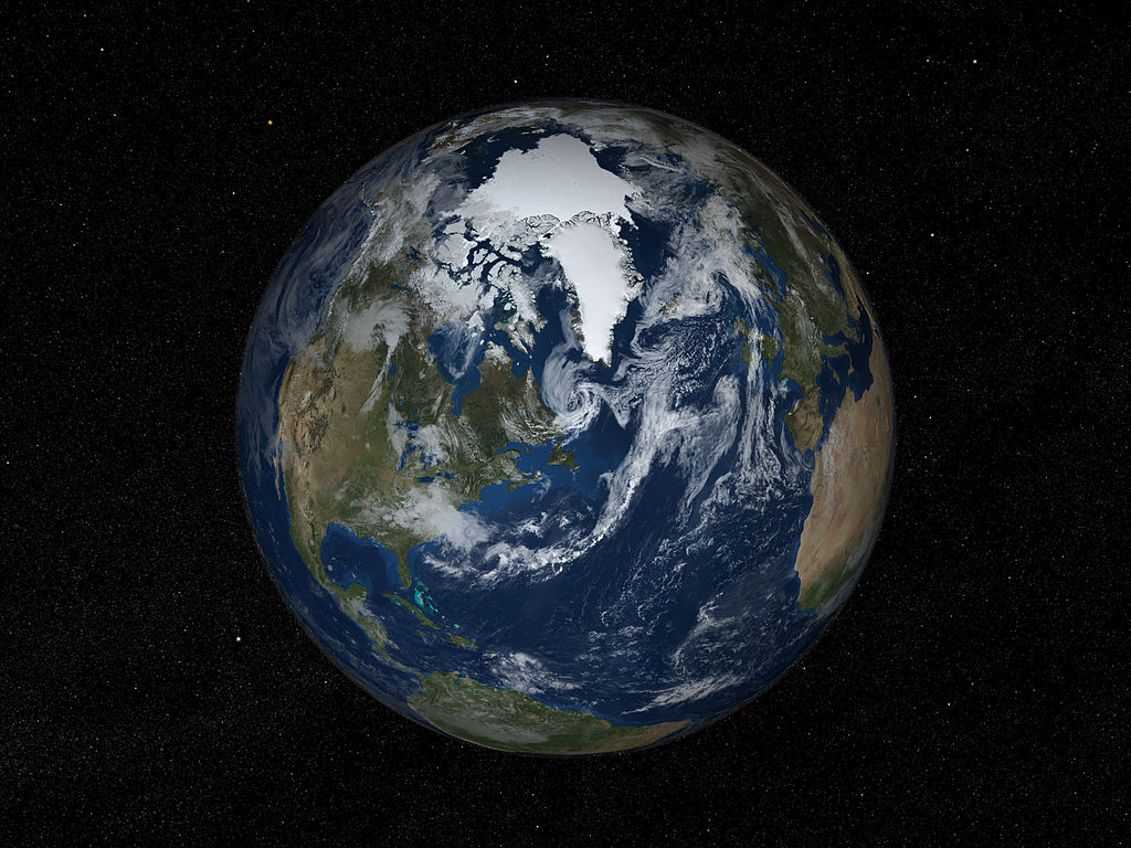 Earth's northern hemisphere with sea ice and clouds