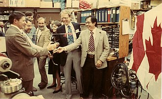 Synchrotron Radiation Center - Ed Rowe (Center) at the opening of a Canadian PRT beamline on Tantalus in 1983
