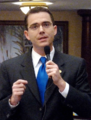 Eric Eisnaugle gestures while commenting during consideration of a measure on the House.png