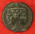 Etruschi, volterra, moneta di bronzo con testa di culsans.JPG