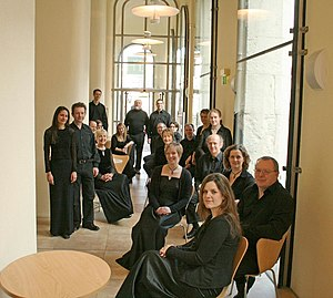 Jeffrey Skidmore - Skidmore (rear, in front of the door) with the Ex Cathedra Choir in the café of the Birmingham Town Hall – photographed on 1 March 2008