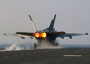 Afterburner - A U.S. Navy F/A-18 Hornet being launched from the catapult on full afterburner.