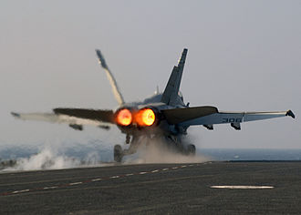 Afterburner - A U.S. Navy F/A-18 Hornet being launched from the catapult on full afterburner