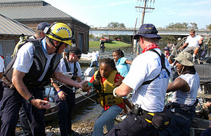 Urban search and rescue - Rescue teams evacuating residents from flooded areas during Hurricane Katrina.