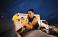 FEMA - 36171 - Volunteers stack sandbags at night in Missouri.jpg