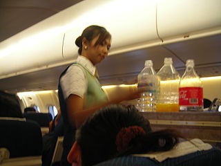 Female flight attendant at work on board of a PBair ATR 72.JPG