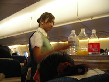 English: PBair female flight attendant at work...