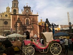 Quinceañera - A fiesta de quince años at the Church of San Martin in San Martín Texmelucan, Puebla, Mexico.