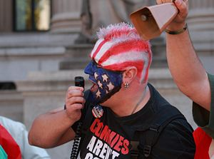 A counter-protester with face and hair colored...
