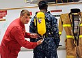 Flickr - Official U.S. Navy Imagery - A Sailor provides training on how to properly don a self-contained breathing apparatus..jpg