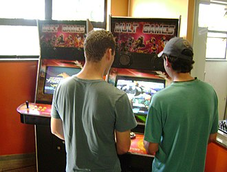 Arcade cabinet - People playing an arcade game