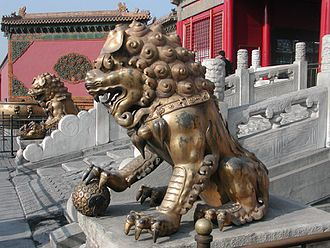 Chinese guardian lions - A Qing-era guardian lion pair in the Forbidden City. Note the different appearance of the face and details in the decorative items, compared to the earlier Ming version.