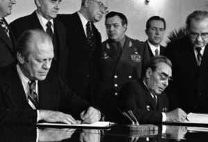 Vladivostok Summit Meeting on Arms Control - American President Gerald Ford and Soviet General Secretary Leonid Brezhnev sign a Joint Communiqué following talks on the limitation of strategic offensive arms in Vladivostok on November 24, 1974.