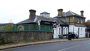 Osterley & Spring Grove tube station - Station buildings next to the bridge over the railway line