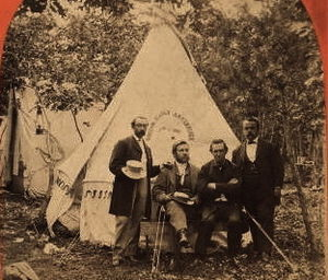 Boston Daily Advertiser - Image: Four men in front of a tent with a sign for the Boston Daily Advertiser, cropped