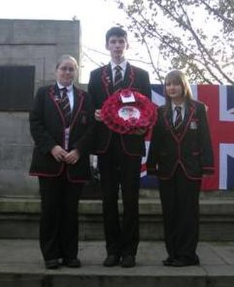 Queen Anne High School, Dunfermline - Queen Anne prefects at local community Remembrance Day service.