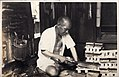 Geta maker - shoemaker at work in Japan (1914 by Elstner Hilton).jpg