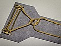 Gold two-pin fibula with housing and chain tied in a Herakles tomb of Philip II Macedon Aigai Vergina Greece 336 BCE.jpg