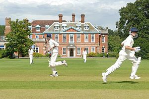 Haberdashers' Aske's Boys' School - Boys playing cricket in front of Aldenham House
