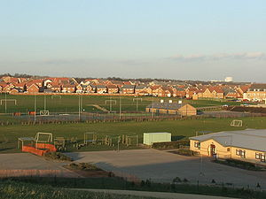 Hampton, Peterborough - Hampton Hargate and part of primary school building in foreground.