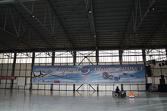 Serbian Air Show - Hangar at Batajnica Air Base featuring air show banner