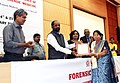 Hansraj Gangaram Ahir presenting the IAFM award (Indian Academy of Forensic Medicine) to Dr. Hasumati Patel.jpg